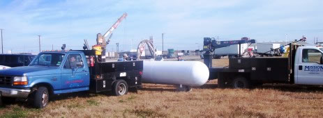 Mission Gas Company installing tanks with two service trucks